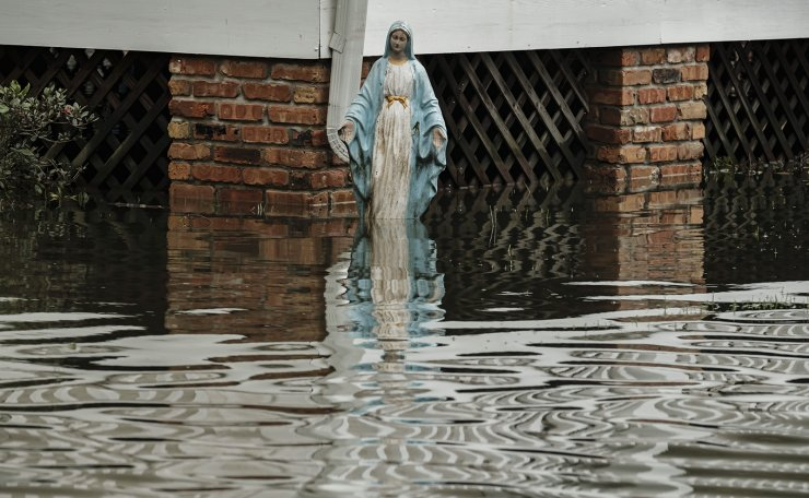 A statue of the Virgin Mary sits in a flooded yard from Hurricane Ida in Barataria, Louisiana, USA, 31 August 2021. EPA
