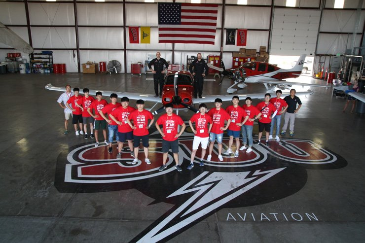 Students from the International Education Exchange Association (IEEA) Global Campus pose in front of an aircraft during a one week summer camp at Southern Utah University which took place from July 20 to July 28. / Courtesy of IEEA Global Campus