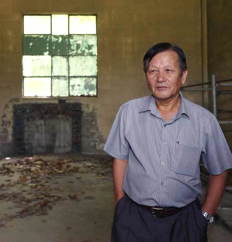 Kim Yong-chang, a former intelligence agent for the U.S. military, stands inside a deserted boiler room where he alleges bodies of killed protesters were incinerated during the May 18 Gwangju Democratization Movement in 1980 during a visit to the site of a former military hospital in Gwangju, Wednesday. Yonhap