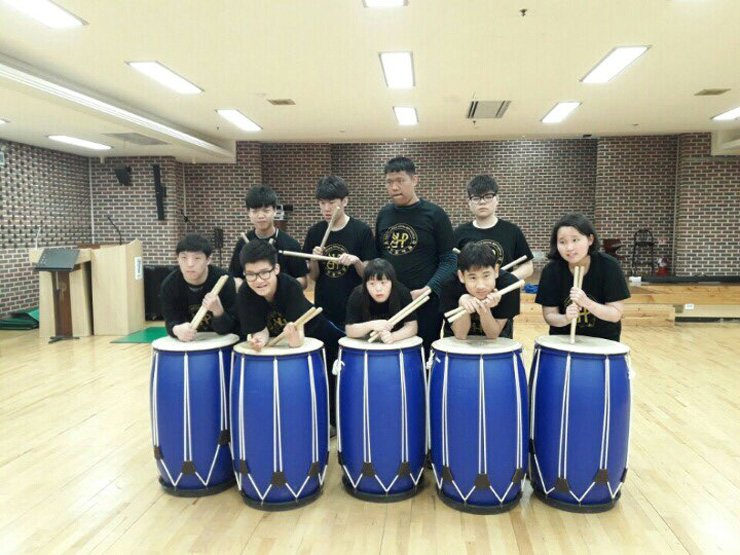 Children with disabilities perform during a recital at a welfare institute in Gayang-dong, western Seoul, July 25. / Courtesy of Lee Eun-ja