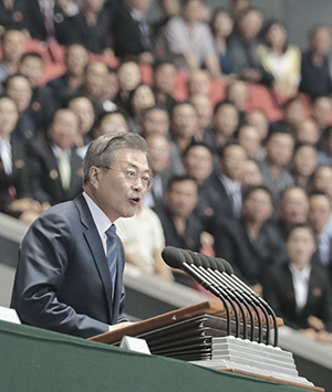 North Koreans applaud as they listen to South Korean President Moon Jae-in's speech at the May Day Stadium in Pyongyang, Wednesday. Joint Press Corps