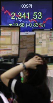 <span>An electronic signboard in the dealing room of Hana Bank in Seoul shows the benchmark KOSPI having fallen 19.68 points, or 0.83 percent, to close at 2,341.53, Friday. Yonhap</span><br /><br />