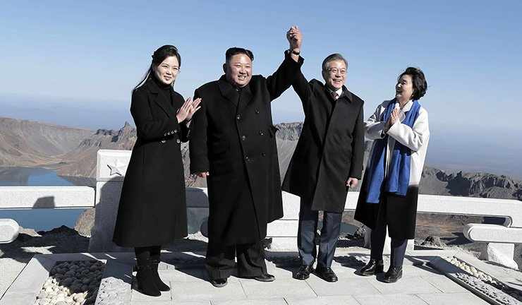 President Moon Jae-in, second from right, and his wife Kim Jung-sook, right, stand with North Korean leader Kim Jong-un, second from left, and his wife Ri Sol-ju on Mount Paektu in North Korea on Sept. 20. Joint Press Corps