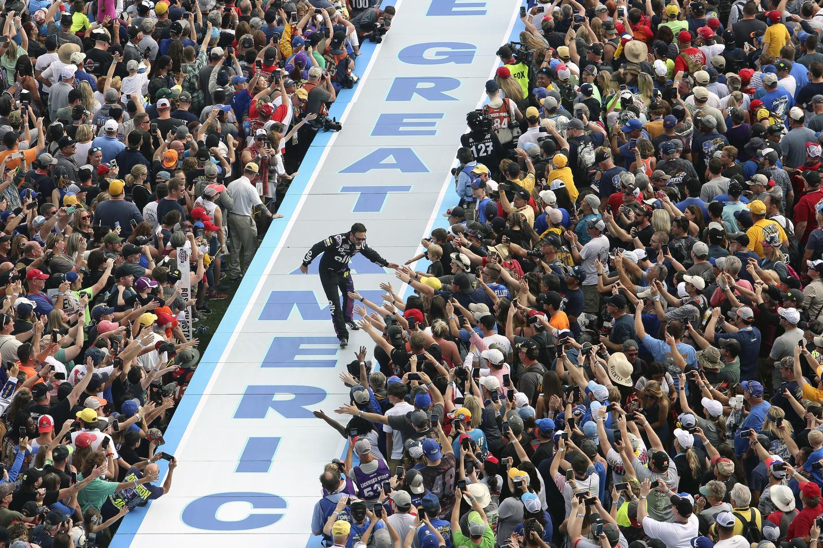 Jimmie Johnson greets fans during driver introductions before the NASCAR Daytona 500 auto race at Daytona International Speedway, Sunday, Feb. 16, 2020, in Daytona Beach, Fla. AP