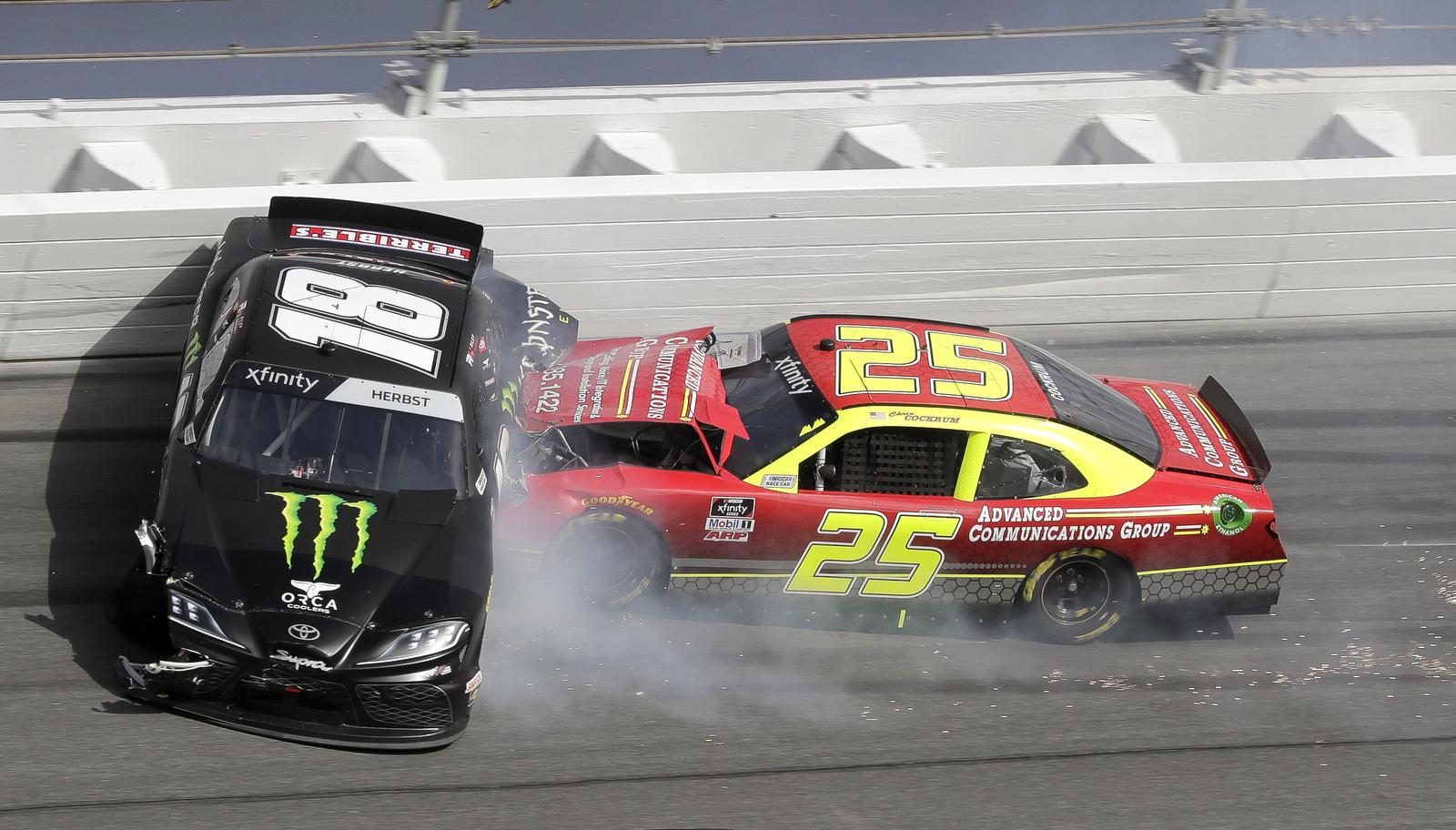 Riley Herbst (18) and Chris Cockrum (25) crash in Turn 3 during the NASCAR Xfinity auto race at Daytona International Speedway, Saturday, Feb. 15, 2020, in Daytona Beach, Fla. AP