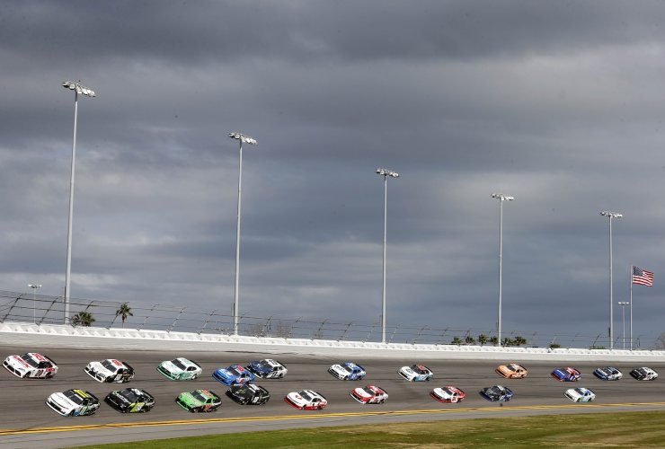 Justin Haley, driver of the #11 LeafFilter Gutter Protection Chevrolet, and Harrison Burton, driver of the #20 Dex Imaging Toyota, lead a pack of cars during the NASCAR Xfinity Series NASCAR Racing Experience 300 at Daytona International Speedway on February 15, 2020 in Daytona Beach, Florida. AFP