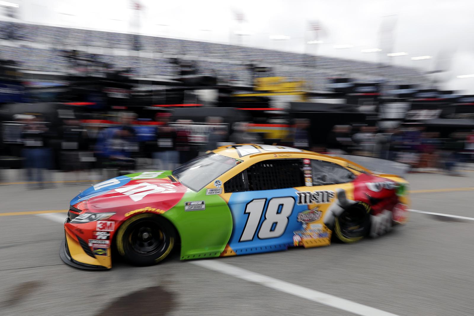 Kyle Busch heads to the track to practice for the NASCAR Daytona 500 auto race at Daytona International Speedway, Friday, Feb. 14, 2020, in Daytona Beach, Fla. AP