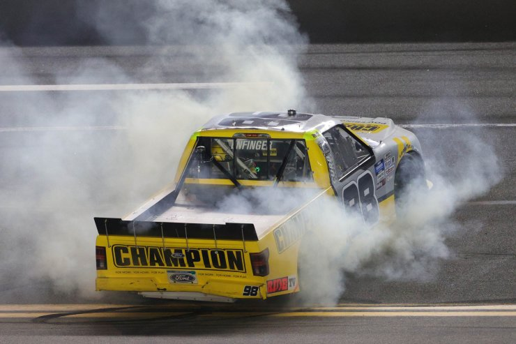 Grant Enfinger, driver of the #98 Champion/Curb Records Ford, celebrates after winning the NASCAR Gander RV & Outdoors Truck Series NextEra Energy 250 at Daytona International Speedway on February 14, 2020 in Daytona Beach, Florida. AFP