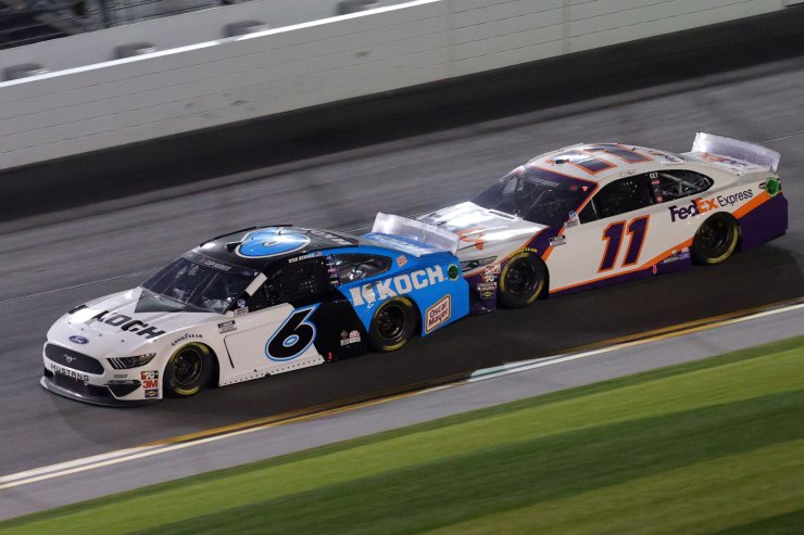 Ryan Newman, driver of the #6 Koch Industries Ford, races Denny Hamlin, driver of the #11 FedEx Express Toyota, during the NASCAR Cup Series 62nd Annual Daytona 500 at Daytona International Speedway on February 17, 2020 in Daytona Beach, Florida. AFP