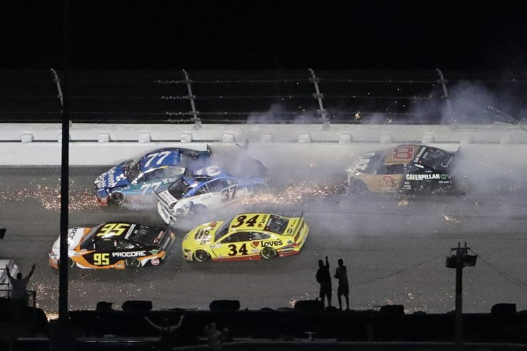 Ross Chastain (77), Ryan Preece (37) and Tyler Reddick (8) crash during the NASCAR Daytona 500 auto race Monday, Feb. 17, 2020, at Daytona International Speedway in Daytona Beach, Fla. Sunday's running of the race was postponed by rain. Getting by are Christopher Bell (95) and Michael McDowell (34). AP