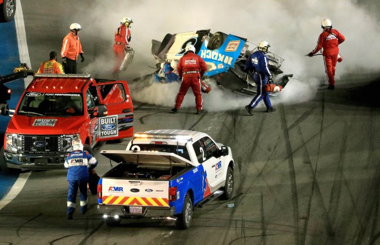 Track workers attend to Ryan Newman, driver of the #6 Koch Industries Ford, following a crash during the NASCAR Cup Series 62nd Annual Daytona 500 at Daytona International Speedway on February 17, 2020 in Daytona Beach, Florida. AFP