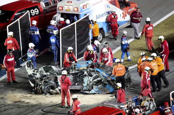 Ryan Newman is moved to an ambulance after rescue workers removed him from his car after he was involved in a crash on NASCAR Daytona 500 auto race at Daytona International Speedway, Monday, Feb. 17, 2020, in Daytona Beach, Fla. Sunday's race was postponed because of rain. AP