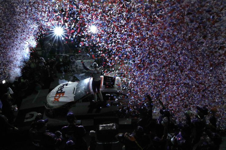 Denny Hamlin, driver of the #11 FedEx Express Toyota, celebrates in Victory Lane after winning the NASCAR Cup Series 62nd Annual Daytona 500 at Daytona International Speedway on February 17, 2020 in Daytona Beach, Florida. AFP