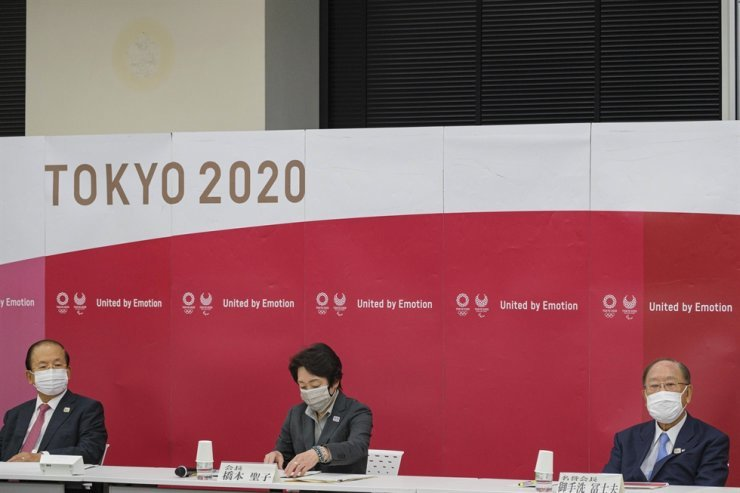 oshiro Muto, chief executive officer of the Tokyo Olympic Organizing Committee, from left, President of the Tokyo 2020 Organizing Committee of the Olympic and Paralympic games Seiko Hashimoto and Canon CEO and Honorary Chairman Fujio Mitarai attend a Tokyo 2020 executive board meeting in Tokyo on May 26. AP-Yonhap