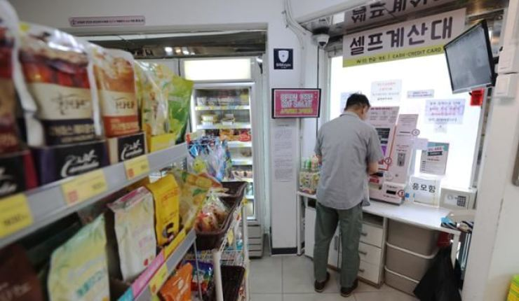 A customer uses a self-payment kiosk at an unmanned store in Seoul, in this July 13 photo. Yonhap