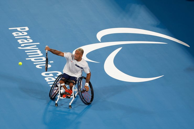 Tokyo 2020 Paralympic Games - Wheelchair Tennis - Men's Singles First Round - Ariake Tennis Park, Tokyo, Japan - August 27, 2021. Carlos Anker of the Netherlands in action against Takashi Sanada of Japan. REUTERS