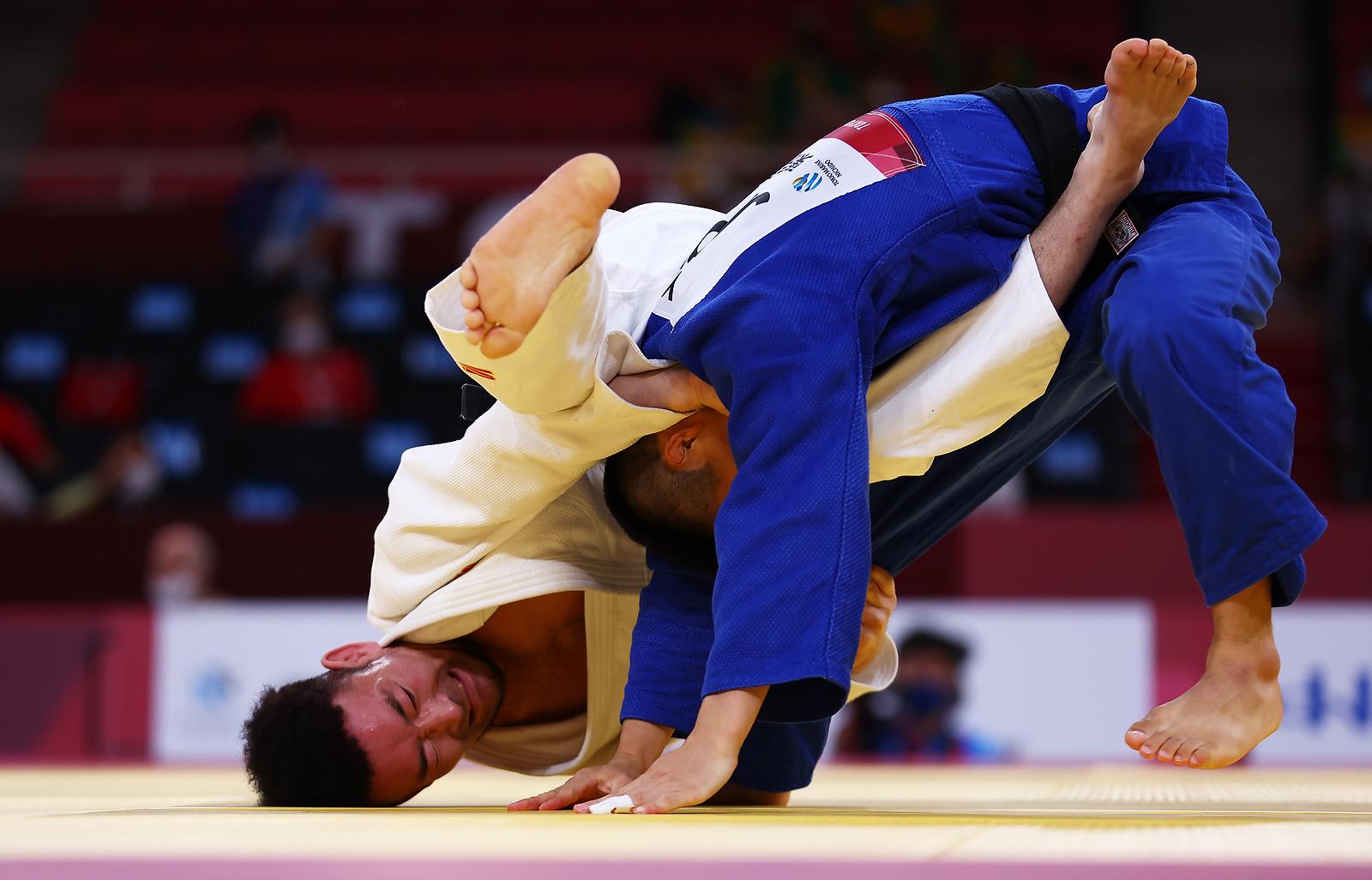Tokyo 2020 Paralympic Games - Men -66 kg Final of Repechage A - Nippon Budokan, Tokyo, Japan - August 27, 2021. Munkhbat Aajim of Mongolia in action against Yujiro Seto of Japan. REUTERS