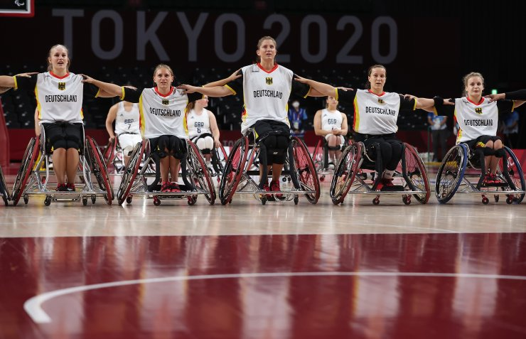 Tokyo 2020 Paralympic Games - Wheelchair Basketball - Women's Preliminary Round Group A - Britain v Germany - Musashino Forest Sport Plaza, Tokyo, Japan - August 27, 2021. Germany players during the anthem. REUTERS