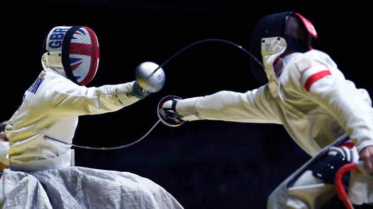 Tokyo 2020 Paralympic Games - Wheelchair Fencing - Men's Epee Team Preliminary Pool 2 ? Makuhari Messe Hall B, Chiba, Japan - August 27, 2021. Oliver Lam-Watson of Britain in action against Michal Nalewajek of Poland. REUTERS