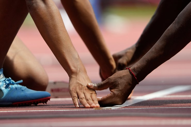 Melissa Baldera of Peru is assisted by her guide at the starting line during the women's 400m T11 at the Tokyo 2020 Paralympics Games in Tokyo, Japan Friday, Aug. 27, 2021. AP