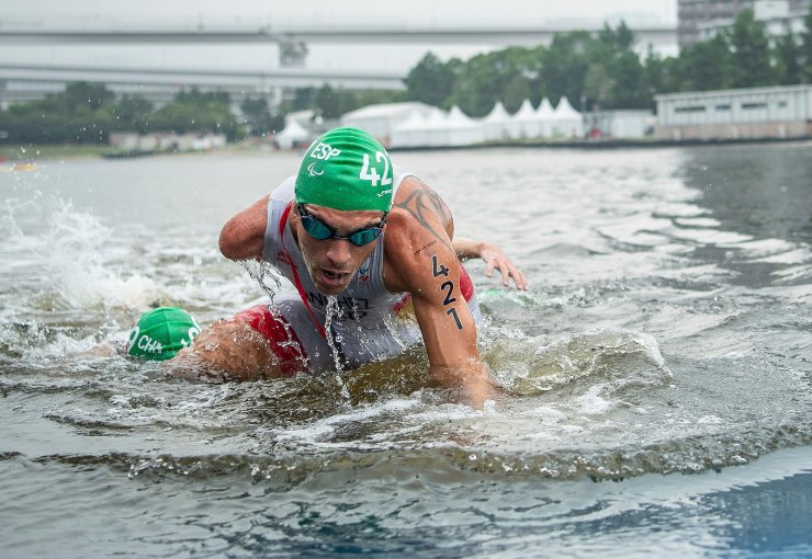 Alejandro Sanchez Palomero, of Spain, leaves the water after the swimming section of the men's triathlon PTS4 at Odaiba Marine Park during the Tokyo 2020 Paralympic Games on Saturday, Aug. 28, 2021, in Tokyo. AP