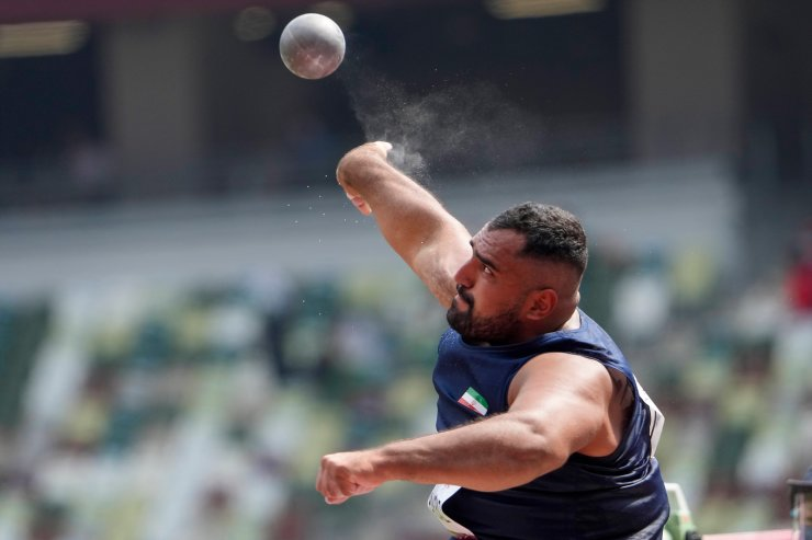 Iran's Saman Pakbaz competes in the men's F12 shot put final during the 2020 Paralympics at the National Stadium in Tokyo, Saturday, Aug. 28, 2021. AP