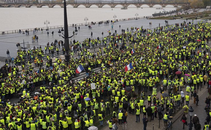 Protesters wearing a yellow vest (gilets jaunes) gather near the city hall of Bordeaux as part of a demonstration over high fuel prices in Bordeaux, South Western France, 01 December 2018. EPA
