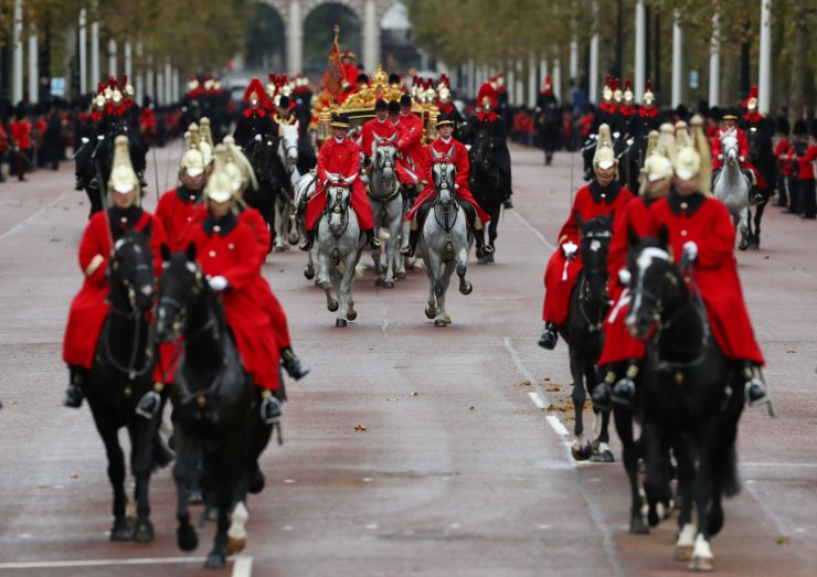 Britain's Queen Elizabeth is driven by carriage as she returns to Buckingham Palace after delivering the State Opening of Parliament in London, Britain October 14, 2019. REUTERS