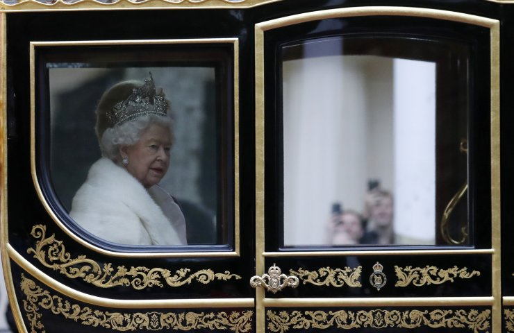 Britain's Queen Elizabeth II travels in a carriage to parliament for the official State Opening of Parliament in London, Monday, Oct. 14, 2019. AP