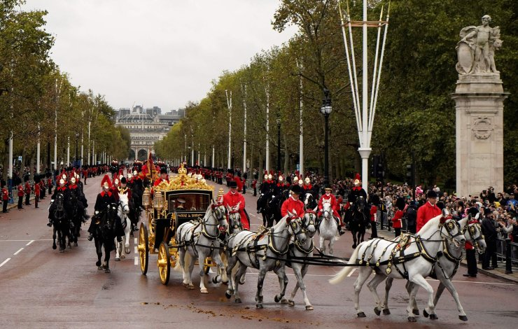 Britain's Queen Elizabeth II rides in the Diamond Jubilee State Coach on the Mall in London on October 14, 2019 as she returns to Buckingham Palace from the Houses of Parliament after attending the State Opening of Parliament. - The State Opening of Parliament is where Queen Elizabeth II performs her ceremonial duty of informing parliament about the government's agenda for the coming year in a Queen's Speech. AFP