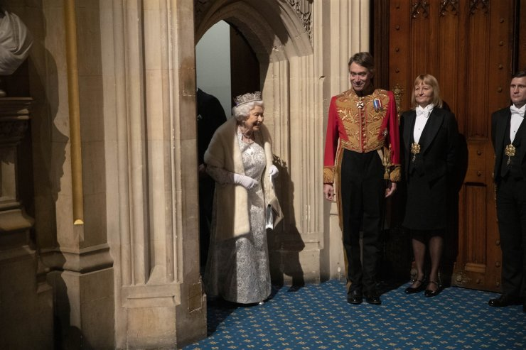 Britain's Queen Elizabeth II arrives in the Norman Porch at the Palace of Westminster and the Houses of Parliament for the State Opening of Parliament ceremony in London, Monday, Oct. 14, 2019. AP
