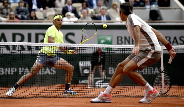 Rafael Nadal of Spain (L) plays Roger Federer of Switzerland during their men's semi final match during the French Open tennis tournament at Roland Garros in Paris, France, 07 June 2019. EPA
