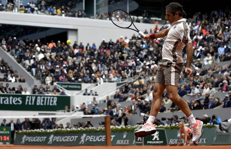 Roger Federer of Switzerland plays Rafael Nadal of Spain during their men's semi final match during the French Open tennis tournament at Roland Garros in Paris, France, 07 June 2019. EPA