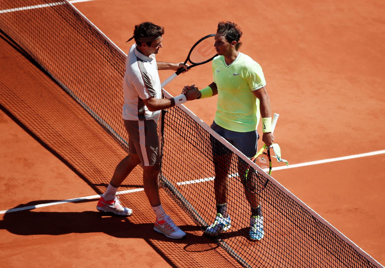 Switzerland's Roger Federer congratulates Spain's Rafael Nadal after their semifinal match. Reuters