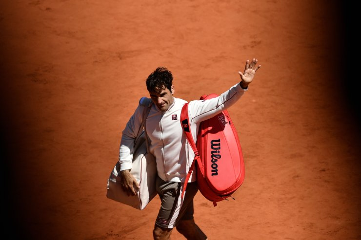 Switzerland's Roger Federer acknowledges the audience after loosing against Spain's Rafael Nadal during their men's singles semi-final match on day 13 of The Roland Garros 2019 French Open tennis tournament in Paris on June 7, 2019. AFP