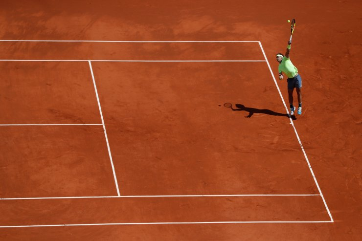 Spain's Rafael Nadal serves against Switzerland's Roger Federer during their semifinal match of the French Open tennis tournament at the Roland Garros stadium in Paris, Friday, June 7, 2019. AP