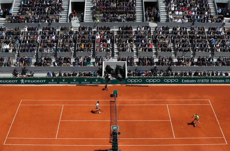 Spain's Rafael Nadal plays a shot against Switzerland's Roger Federer, left, during their semifinal match of the French Open tennis tournament at the Roland Garros stadium in Paris, Friday, June 7, 2019. AP