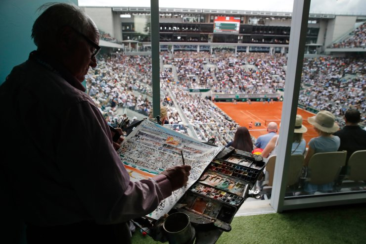 An artist paints an aquarelle, or watercolor, of the men's final match of the French Open tennis tournament between Spain's Rafael Nadal and Austria's Dominic Thiem at the Roland Garros stadium in Paris, Sunday, June 9, 2019. AP
