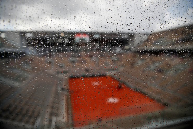 Rain drops trickle down a glass wall on center court as showers interrupted the men's semifinal match of the French Open tennis tournament between Serbia's Novak Djokovic and Austria's Dominic Thiem at the Roland Garros stadium in Paris, Saturday, June 8, 2019. AP