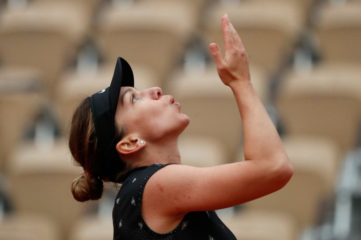 Romania's Simona Halep celebrates winning her second round match of the French Open tennis tournament against Poland's Magda Linette in three sets 6-4, 5-7, 6-3, at the Roland Garros stadium in Paris, Thursday, May 30, 2019. AP