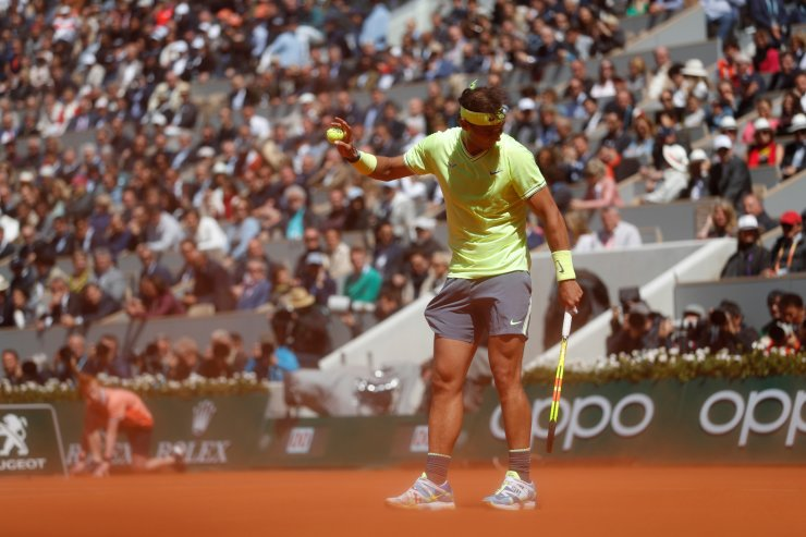 Spain's Rafael Nadal asks for a pause as wind kicks up red clay dust during his semifinal match of the French Open tennis tournament against Switzerland's Roger Federer at the Roland Garros stadium in Paris, Friday, June 7, 2019. AP