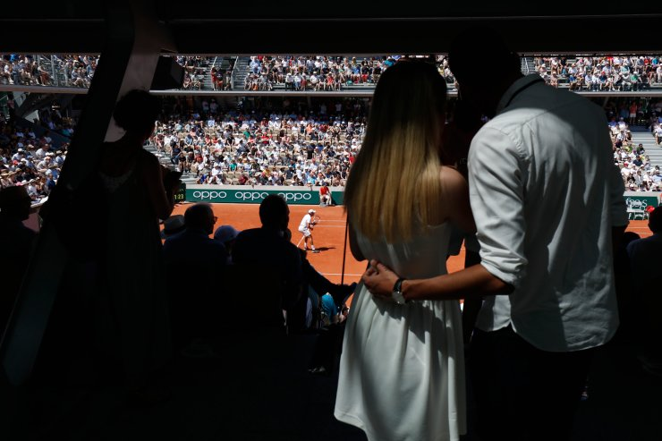 Spectators watch Serbia's Dusan Lajovic plays a shot against Germany's Alexander Zverev during their third round match of the French Open tennis tournament at the Roland Garros stadium in Paris, Saturday, June 1, 2019. AP
