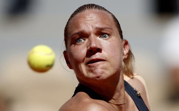 Kaia Kanepi of Estonia plays Petra Martic of Croatia during their women's round of 16 match during the French Open tennis tournament at Roland Garros in Paris, France, 02 June 2019. EPA