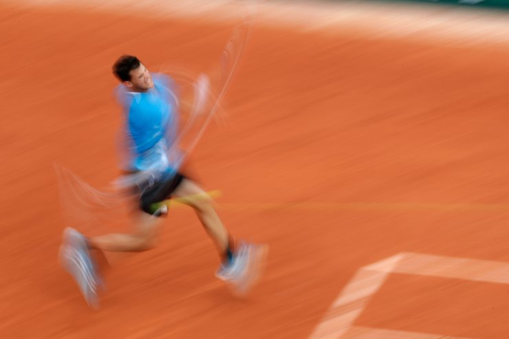 Austria's Dominic Thiem plays a shot against France's Gael Monfils during their fourth round match of the French Open tennis tournament at the Roland Garros stadium in Paris, Monday, June 3, 2019. AP