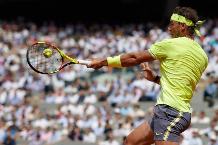 Spain's Rafael Nadal returns the ball to Japan's Kei Nishikori during their men's singles quarter-final match on day ten of The Roland Garros 2019 French Open tennis tournament in Paris on June 4, 2019. AFP
