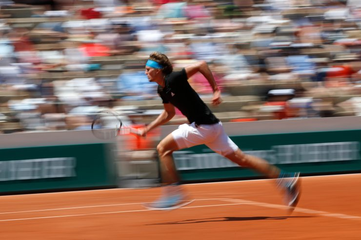 Germany's Alexander Zverev runs to the net to play a shot against Serbia's Dusan Lajovic during their third round match of the French Open tennis tournament at the Roland Garros stadium in Paris, Saturday, June 1, 2019. AP