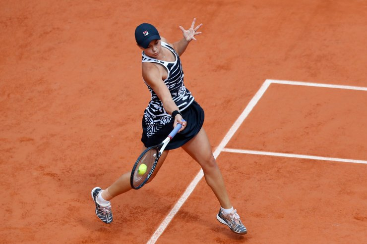 Australia's Ashleigh Barty plays a shot against Marketa Vondrousova of the Czech Republic during the women's final match of the French Open tennis tournament at the Roland Garros stadium in Paris, Saturday, June 8, 2019. AP