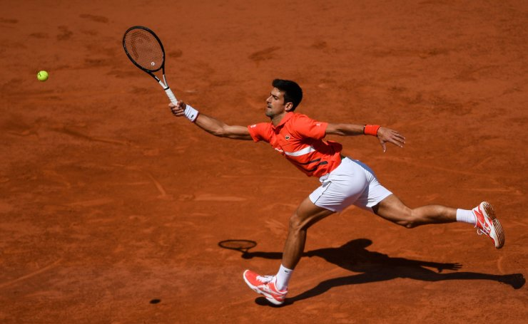 <span>Serbia's Novak Djokovic returns the ball to Germany's Alexander Zverev during their men's singles quarter-final match on day twelve of The Roland Garros 2019 French Open tennis tournament in Paris on June 6, 2019. AFP</span><br /><br />