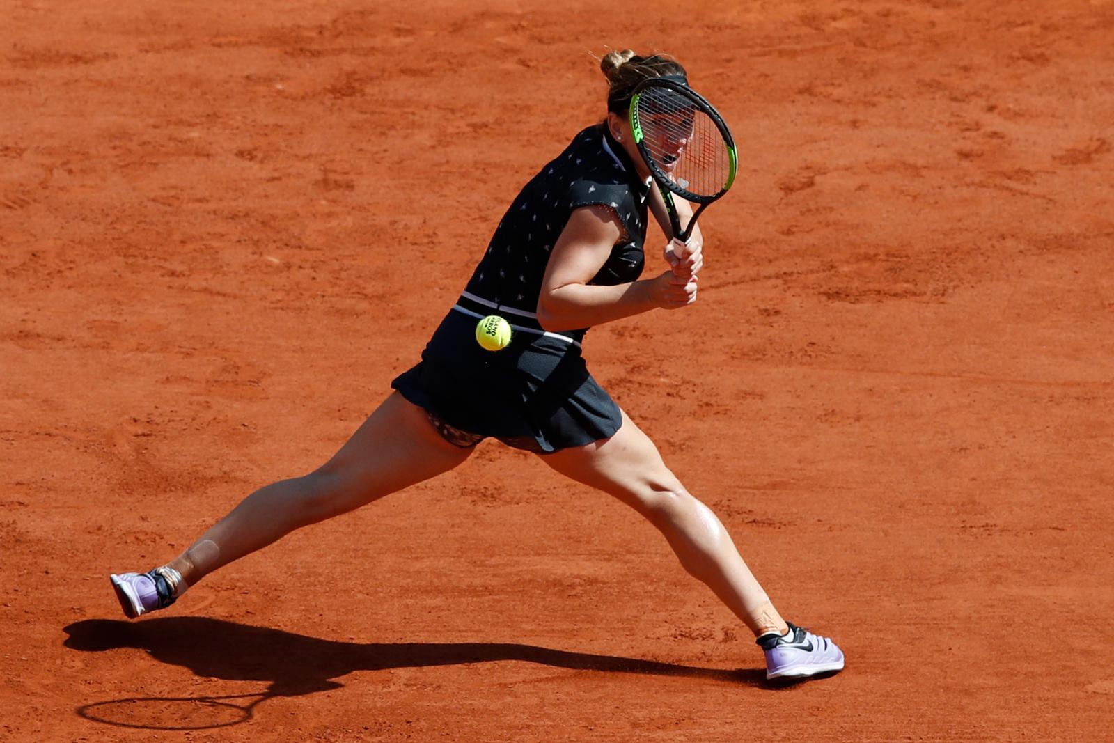 Romania's Simona Halep plays a shot against Ukraine's Lesia Tsurenko during their third round match of the French Open tennis tournament at the Roland Garros stadium in Paris, Saturday, June 1, 2019. AP