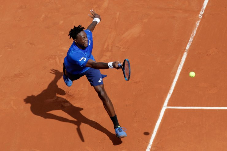 France's Gael Monfils plays a shot against Austria's Dominic Thiem during their fourth round match of the French Open tennis tournament at the Roland Garros stadium in Paris, Monday, June 3, 2019. AP